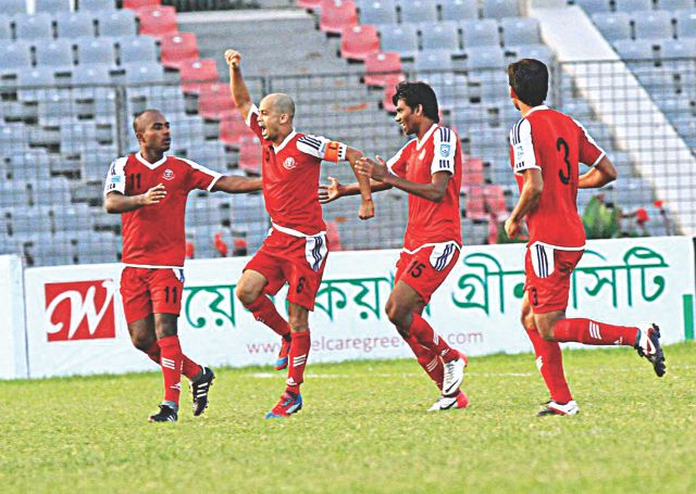 Muktijoddha Sangsad midfielder Zahed Parvez (2nd from L) celebrates after scoring the first goal against Feni Soccer Club during their Super Cup match at the Bangabandhu National Stadium yesterday. PHOTO: STAR
