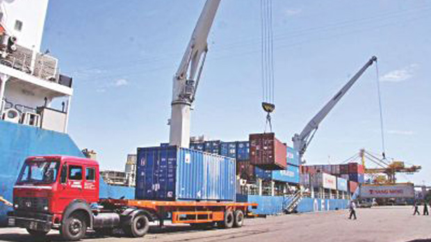 The file photo shows containers being trucked out of Chittagong Port. The Ticfa will open up opportunities for Bangladesh and the US to further broaden bilateral trade relations.