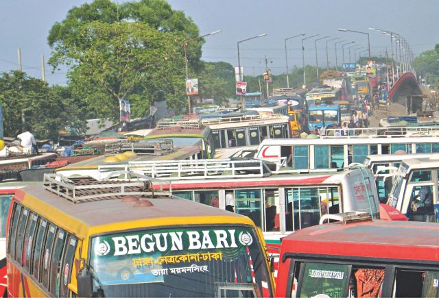 This recent photo shows a traffic gridlock and a long queue of buses at Mymensingh bus terminal that stretches over Shambhuganj bridge. Locals say that such jams are a regular phenomenon and sometimes last an entire day. Photo: Aminul Islam