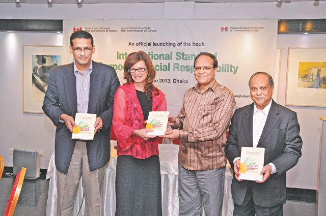 From left, Mortoza Tarafder, trade commissioner at the Canadian High Commission; Heather Cruden, Canadian high commissioner; Atiur Rahman, governor of Bangladesh Bank, and KM Khaled, president of Canada Bangladesh Chamber of Commerce and Industry, pose at the launch of a book on corporate social responsibility in Dhaka yesterday. Photo: CanCham