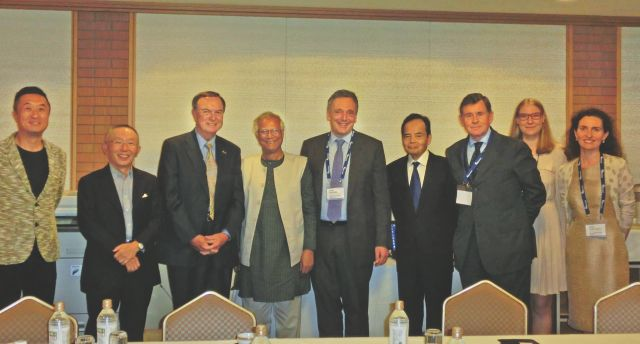 From left, Professor Okada; Tadashi Yanai, chairman and CEO of Uniqlo; Michael Duke, president of Wal-Mart; Nobel Laureate Muhammad Yunus; Gareth Ackerman, chairman of Pick and Pay Stores; Motoya Okada, president of AEON Co Ltd; Georges Plassat, CEO of Carrefour; Marie-Benedicte Beaudoin of Consumer Goods Forum; and Rhoda Lane-O'Kelly of Consumer Goods Forum, pose at a recent conference in Tokyo. Photo: Yunus Centre