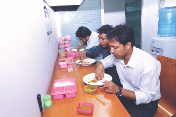 Employees at numerous banks, insurance companies and IT firms across Dhaka depend on the tiffin-wallahs for their lunch. Photo: Prabir Das