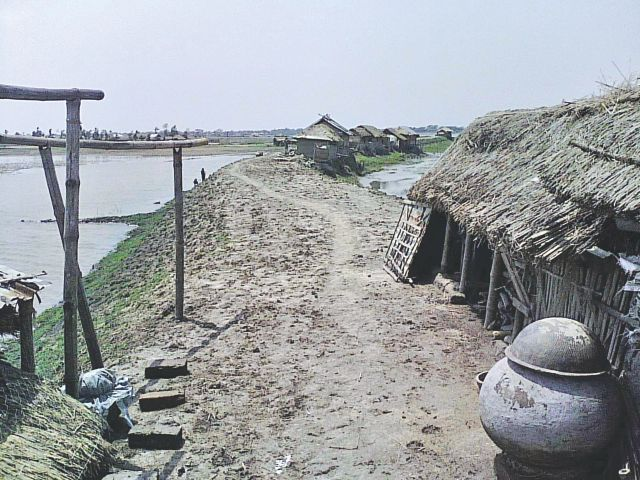 Many cyclone Aila victims still live on the embankment in Dakop, Khulna. Even though four years have gone by since the storm made a landfall, many have not been able to return to their homes as they have lost their means of livelihood.  Photo: Pinaki Roy
