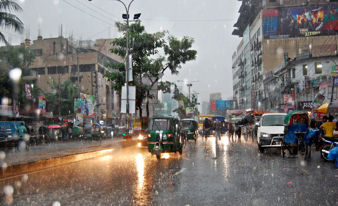 Rain falls amid the hustle and bustle of city life. The Focus Bangla photo was taken from Gulistan area on Wednesday afternoon.
