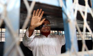 This August 22 file photo shows Jamaat leader Azharul Islam waves to onlookers as he is put into a prison van after his arrest at his Moghbazar home in the capital in connection with crimes against humanity committed during the Liberation War.