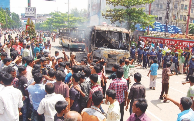 After a garment worker dies in a road accident near Agrabad, Chittagong garment workers vandalise vehicles on the road.  Photo: Prabir Das