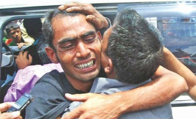 This July 8 photo shows Mohammed Rubel, a crewman of Bangladesh vessel MV Hope, breaks down in tears upon seeing his brother after he returned home alive, four days after the vessel tilted in the Andaman sea.
