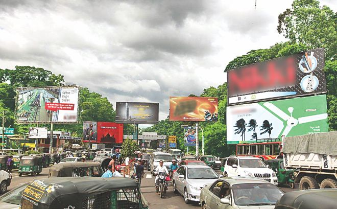 Numerous billboards have been set up on the railway land in Tiger Pass area of the port city, blocking the view of the hills and the greenery. Photo: Anurup Kanti Das