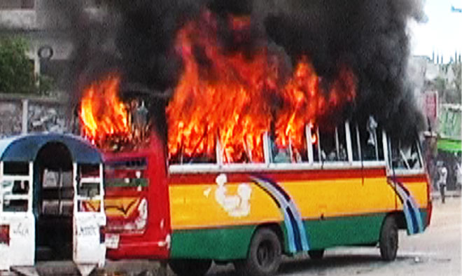 Jamaat-Shibir pickets set fire to a bus in Gazipur during the countrywide daylong hartal (shutdown) on Tuesday. Photo: Star