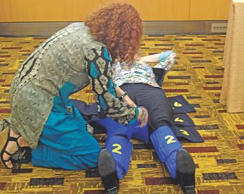 """Demonstration of a non-pneumatic anti-shock garment (NASG) - also called a """"lifewrap"""" - to stop post-partum haemorrhage at a seminar in the Women Deliver conference in Kuala Lumpur, Malaysia in May 2013.PHOTO: DR TAREQ SALAHUDDIN"""