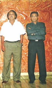 The writer, right, with his teacher