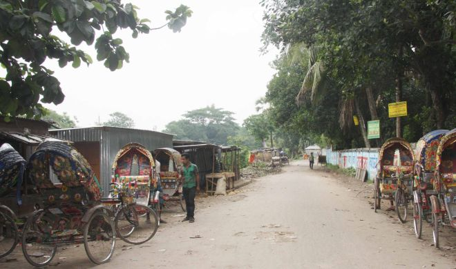 The road near Tangail Stadium turns a safe haven for drug peddlers and muggers at night amid alleged negligence of law enforcers. PHOTO: STAR