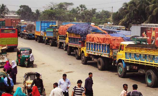 Vehicles are seen stranded on Dhaka-Chittagong highway at Gouripur area in Daukandi upazila of Comilla Friday afternoon. Photo: Star