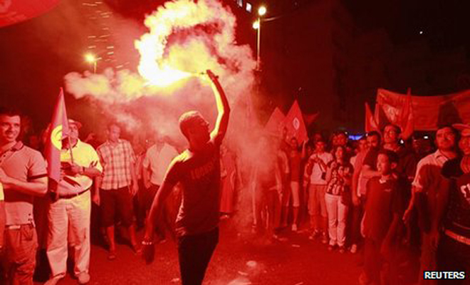 The protesters set off flares and chanted slogans
