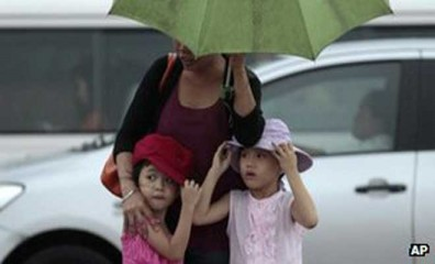 Rain has fallen in the capital, Manila, and some schools are closed
