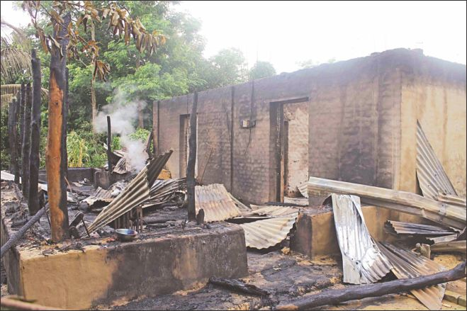 Smoke bellows from a house in Bagapara of Matiranga in Khagrachhari on Saturday after Bangalee settlers attacked the homes of indeginous people. The photo was taken on Sunday. Photo: Star