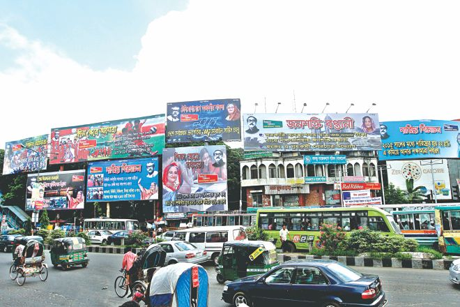 "These photos taken from Shahbagh, top, Moghbazar intersection, Ruposhi Bangla intersection, Manik Mia Avenue, and Mirpur-10 intersection in the capital show large hoardings advertising the ""successes"" of the Awami League-led government. The ruling party did not bother to rent or buy the billboards."