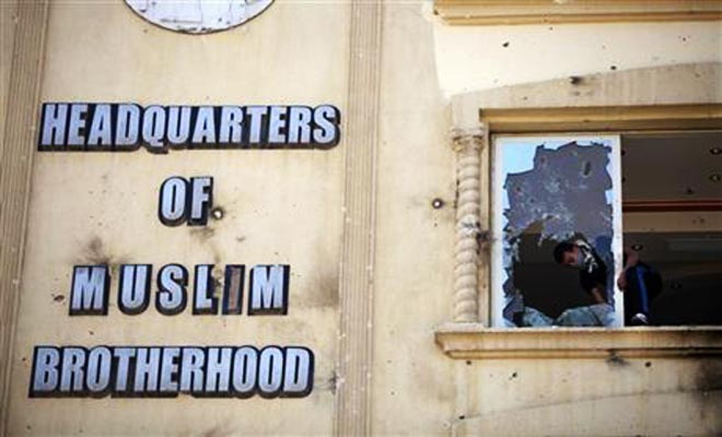 In this July AP file photo, an Egyptian protester ransacks the Muslim Brotherhood headquarters in the Muqatam district in Cairo.