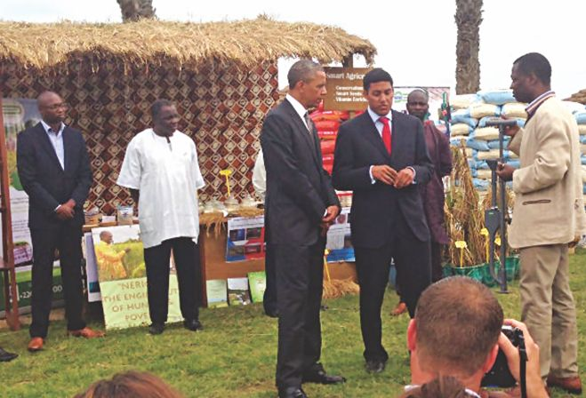 US President Barack Obama listens to USAID Administrator Rajib Shah briefing on Guti applicators at an exhibition in Senegal late June. Photo Courtesy: IFDC