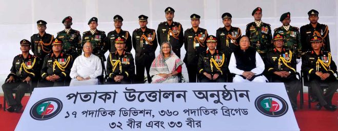 """Prime Minister Sheikh Hasina with civil and military dignitaries at a ceremony to raise the flag of a new """"17 Infantry Division"""" of Bangladesh Army at a ceremony in Jalalabad Cantonment in Sylhet on Tuesday. Photo: ISPR"""