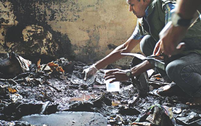 Detectives collect samples from the scene at Jamiatul Ulum Al Islamia Madrasa in Chittagong city yesterday where a blast left seven students wounded the day before. Law enforcers are trying to identify the explosives. The Islamic education centre is run by a Hefajat-e Islam leader.   Photo: Star
