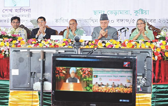 Indian Prime Minister Manmohan Singh speaks from his New Delhi office through a video conference at the inauguration of Bangladesh-India Power Transmission Centre at Bheramara in Kushtia yesterday. The foundation plaque for controversial Rampal power plant was also unveiled at the programme. Seated right to left, Bangladesh Prime Minister Sheikh Hasina, Indian Minister for New and Renewable Energy Dr Farooq Abdullah, Hasina's Energy Adviser Tawfiq-e-Elahi, and Shubid Ali Bhuiyan, chairman of parliamentary standing committee on power ministry. Photo: BSS
