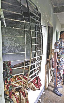 Iron grills of a window badly bent by the powerful blast at the madrasa, run by a Hefajat leader. Photo: Anurup Kanti Das
