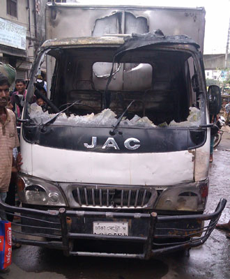 Miscreants set fire to a pick-up van in the capital's Bangabazar area Tuesday afternoon soon after a tribunal awarded BNP lawmaker Salauddin Quader Chowdhury death penalty for his wartime offences. Photo: Star