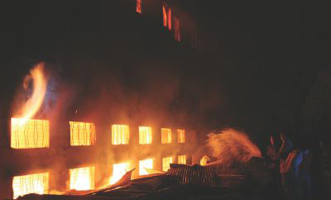 This November 24, 2012 file photo shows a scene of Tazreen Fashions Ltd fire. The fire that broke out in Ashulia, on the outskirt area of the capital, took the lives of at least 112 workers.