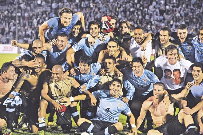 Uruguay players celebrate their qualification into the 2014 World Cup at the end of the intercontinental play-off against Jordan in Montevideo on Wednesday. Photo: AFP