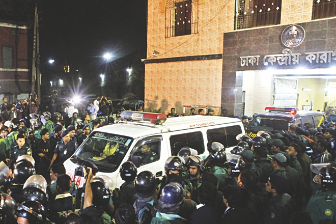 Three ambulances, one of them carrying the body of executed war criminal Quader Mollah, leave Dhaka Central Jail at 11:15pm yesterday for Faridpur where he would be buried.  Photo: Star
