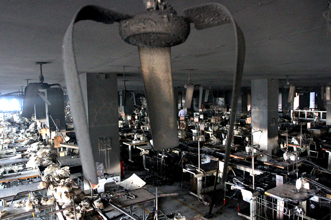 Mindless Act Of Arson: The raging fire destroyed all equipment, inside a factory building and the heat even bent the fan blades. Photo: Palash Khan/ BGMEA