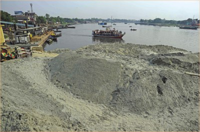 This April 30, 2011 file photo shows the continuous earth-filling near Fatullah terminal pontoon in Narayanganj for sand trading stretches far into the flow of Buriganga, changing the launch channel.